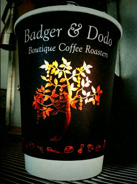 Badger & Dodo Coffee Roasters & Barista Training - image of take away coffee cup with Badger and Dodo Logo